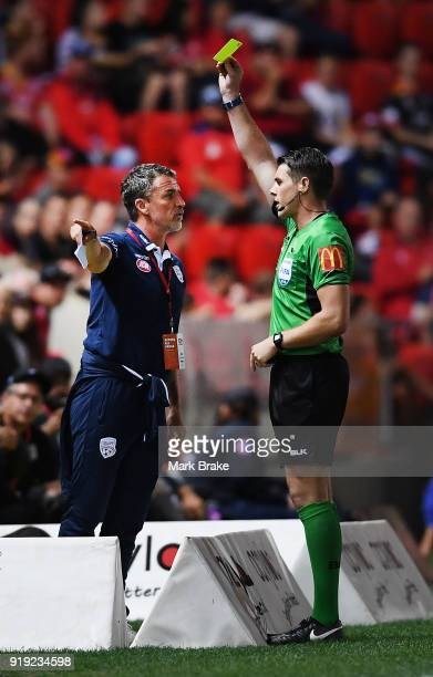 Marco Kurz coach of Adelaide United gets a yellow card from referee Shaun Evans during the round 20 ALeague match between Adelaide United and the...