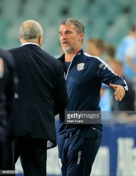 Marco Kurz Head Coach of Adelaide United congratulates Graham Arnold Coach of Sydney FC after the round 26 ALeague match between Sydney FC and...