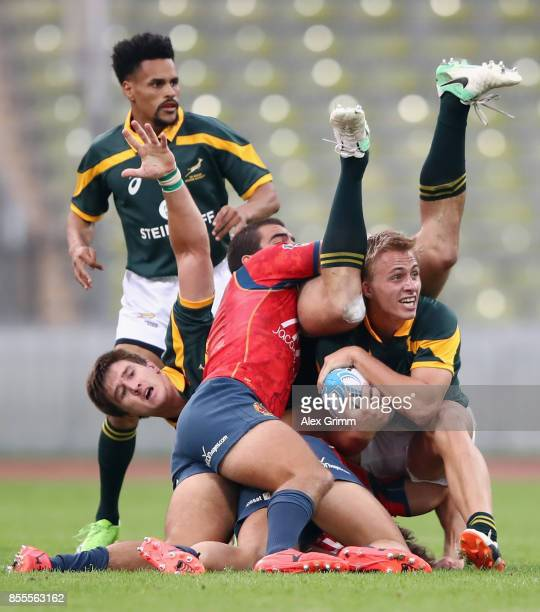 Marco Labuschagne and Impi Visser of South Africa are tackled by Rafael de Santiago of Spain during the match between South Africa and Spain on Day 1...