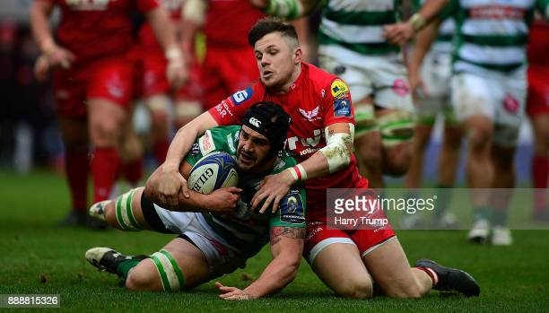 Marco Lazzaroni of Benetton Rugby is tackled by Steffan Evans of Scarlets during the European Rugby Champions Cup match between Scarlets and Benetton...