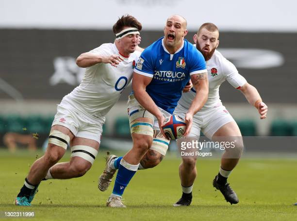 Marco Lazzaroni of Italy is tackled by Tom Curry and Luke Cowan-Dickie during the Guinness Six Nations match between England and Italy at Twickenham...