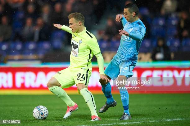 Marco Lund of Esbjerg fB and Nikola Djurdjic of Randers FC compete for the ball during the Danish Alka Superliga match between Randers FC and Esbjerg...