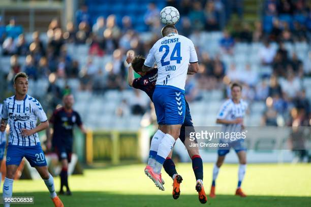 Marco Lund of OB Odense heading the ball during the Danish Alka Superliga match between OB Odense and AGF Arhus at EWII Park on May 13 2018 in Odense...