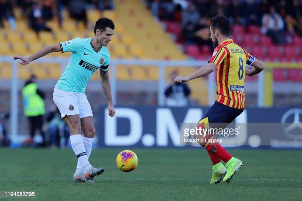 Marco Mancosu of Lecce competes for the ball with Antonio Candreva of Inter during the Serie A match between US Lecce and FC Internazionale at Stadio...