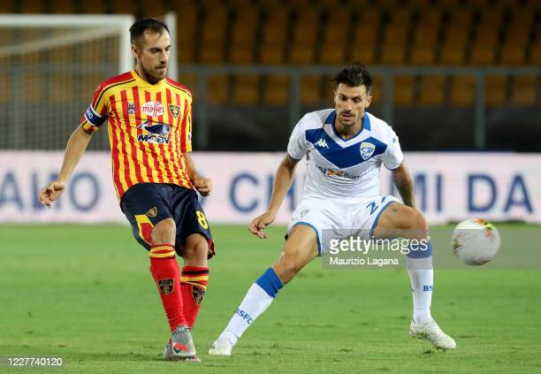 Marco Mancosu of Lecce competes for the ball with Daniele Desena of Brescia during the Serie A match between US Lecce and Brescia Calcio at Stadio...