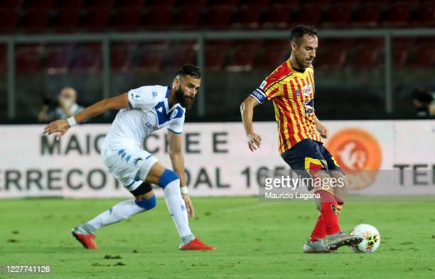 Marco Mancosu of Lecce competes for the ball with Jhon Chancellor of Brescia during the Serie A match between US Lecce and Brescia Calcio at Stadio...