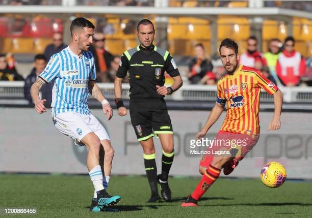 Marco Mancosu of Lecce competes for the ball with Mirko Valdifiori of Spal during the Serie A match between US Lecce and SPAL at Stadio Via del Mare...