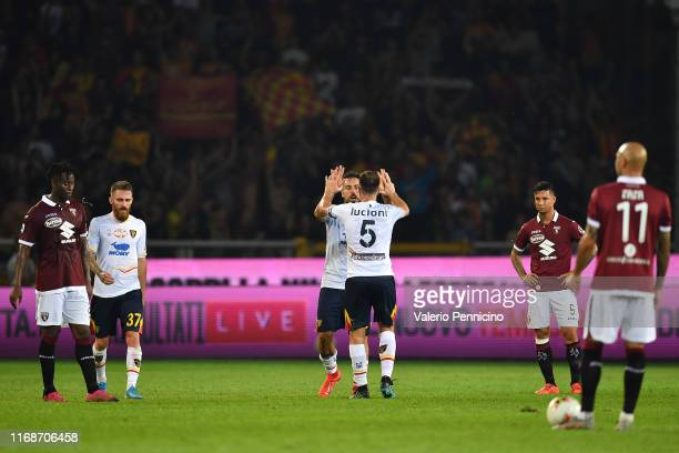 Marco Mancosu of US Lecce celebrates a goal with team mate Fabio Lucioni during the Serie A match between Torino FC and US Lecce at Stadio Olimpico...