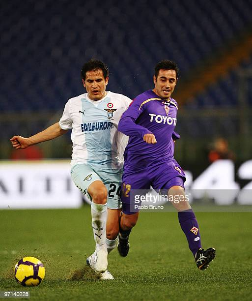 Marco Marchionni of ACF Fiorentina and Cristian Ledesma of SS Lazio compete for the ball during the Serie A match between Lazio and Fiorentina at...