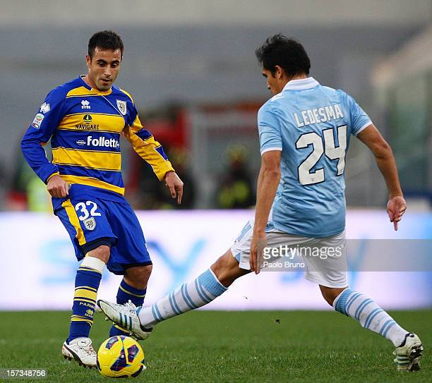 Marco Marchionni of Parma FC competes for the ball with Cristian Ledesma of SS Lazio during the Serie A match between SS Lazio and Parma FC at Stadio...