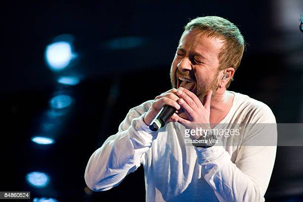Marco Masini performs onstage on opening night of the 59th San Remo Song Festival at the Ariston Theatre on February 17 2009 in San Remo Italy