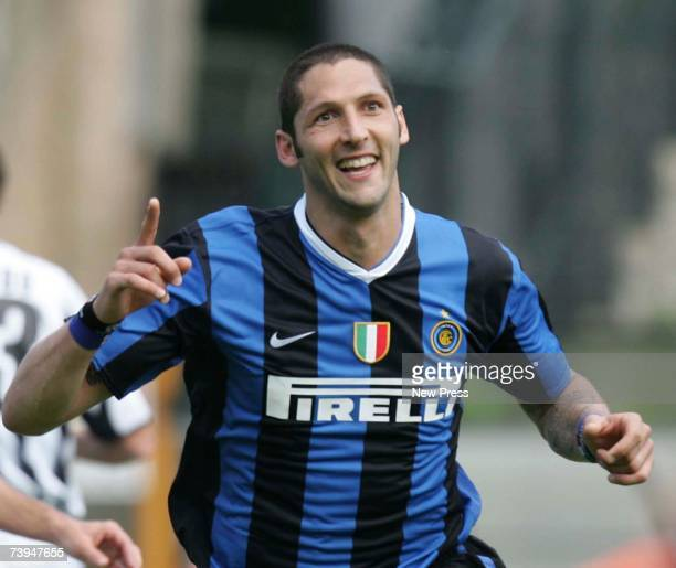 Marco Materazzi celebrates after scoring one of Inter's two goals during the Italian Serie A football match between AC Siena and FC Inter Milan at...
