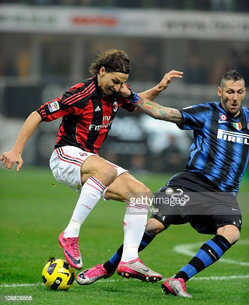 Marco Materazzi of FC Internazionale Milano and Zlatan Ibrahimovic of AC Milan compete for the ball during the Serie A match between FC Inter and AC...