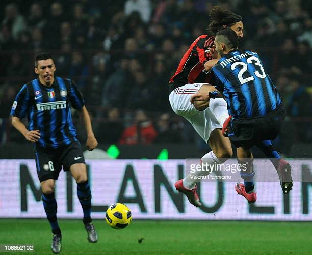 Marco Materazzi of FC Internazionale Milano clashes with Zlatan Ibrahimovic of AC Milan during the Serie A match between FC Internazionale Milano and...