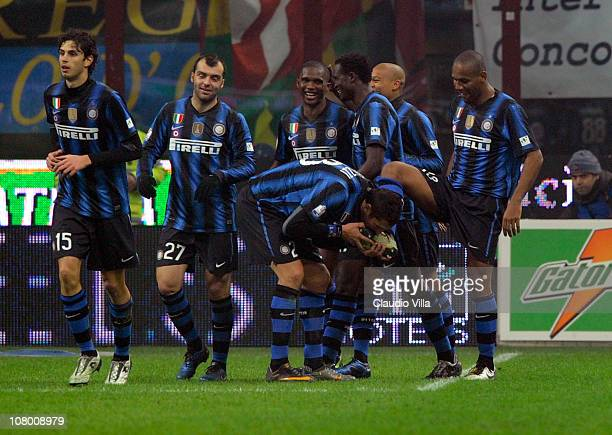 Marco Materazzi of FC Internazionale Milano kisses Maicon's shoe during the Tim Cup match between Inter and Genoa at Stadio Giuseppe Meazza on...