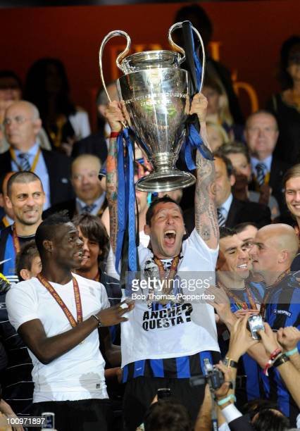 Marco Materazzi of Inter Milan celebrates with the trophy after winning the UEFA Champions League Final match between Bayern Munich and Inter Milan...