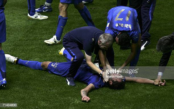 Marco Materazzi of Italy celebrates following his team's victory in a penalty shootout at the end of the FIFA World Cup Germany 2006 Final match...