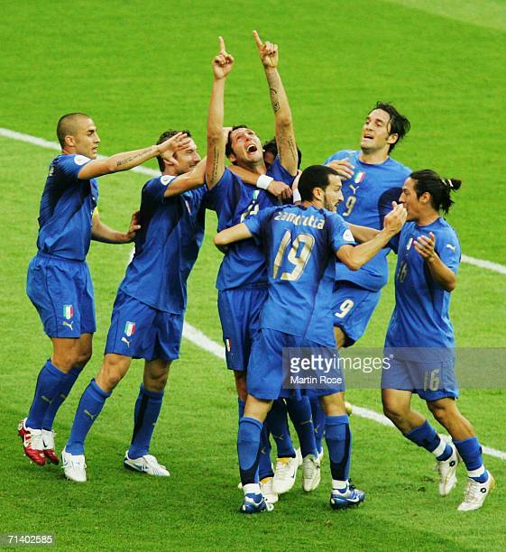 Marco Materazzi of Italy celebrates scoring his team's first goal with his team mates during the FIFA World Cup Germany 2006 Final match between...