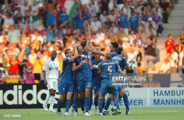 Marco Materazzi of Italy celebrates with teammates after scoring the 1-1 goal during the World Cup 2006 final football game Italy and France, 09 July...