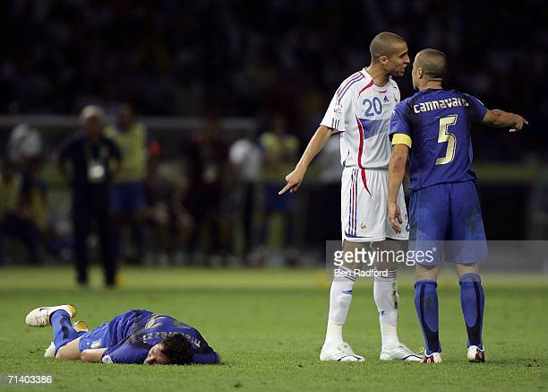 Marco Materazzi of Italy lies injured on the pitch after being headbutted in the chest by Zinedine Zidane of France during the FIFA World Cup Germany...
