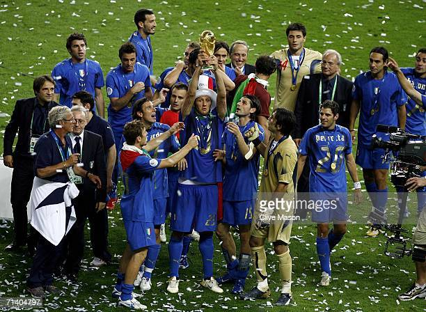 Marco Materazzi of Italy lifts the World Cup trophy aloft following victory at the end of the FIFA World Cup Germany 2006 Final match between Italy...