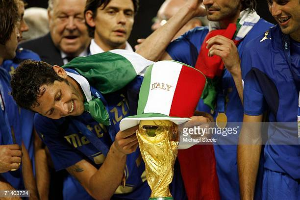 Marco Materazzi of Italy places an Italian hat onto the world cup trophy during the FIFA World Cup Germany 2006 Final match between Italy and France...