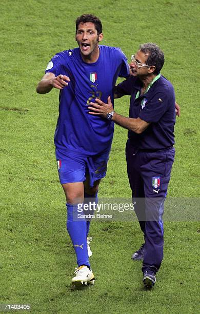 Marco Materazzi of Italy reacts following treatment after being headbutted in the chest by Zinedine Zidane of France during the FIFA World Cup...