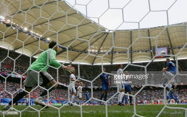 Marco Materazzi of Italy rises to score the opening goal past Petr Cech of Czech Republic during the FIFA World Cup Germany 2006 Group E match...