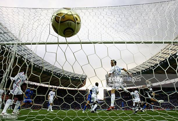 Marco Materazzi of Italy shoots past Goalkeeper Fabien Barthez of France to score a goal and level the scores at 1-1 during the FIFA World Cup...