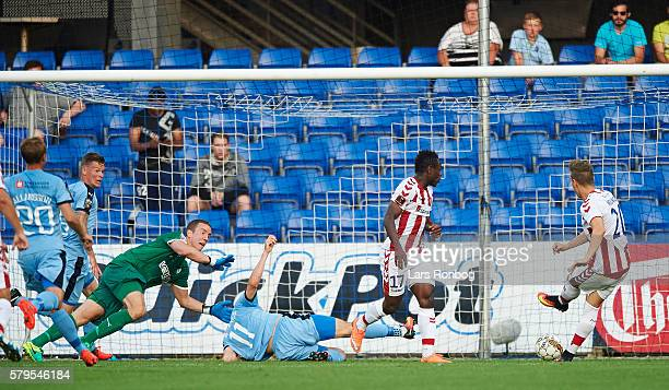 Marco Meilinger of AaB Aalborg scores the 10 goal against Goalkeeper Hannes Halldorsson of Randers FC during the Danish Alka Superliga match between...