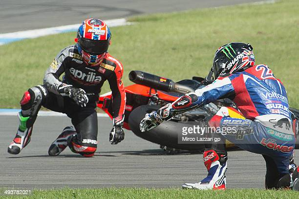 Marco Melandri of Italy and Aprilia Racing Team and Alexander Lowes of Great Britain and Voltcom Crescent Suzuki crashed out during the race 2 of...