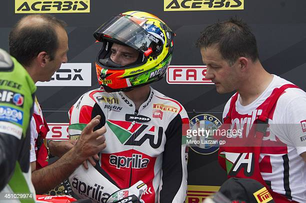 Marco Melandri of Italy and Aprilia Racing Team celebrates the third place under the podium at the end of the Superbike race 1 during the FIM...