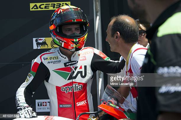 Marco Melandri of Italy and Aprilia Racing Team celebrates the third place under the podium at the end of the Superbike race 2 during the FIM...