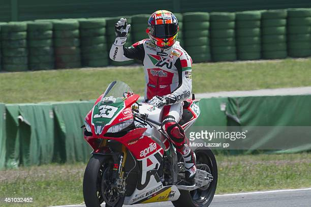 Marco Melandri of Italy and Aprilia Racing Team celebrates the third place at the end of the Superbike race 1 during the FIM Superbike World...