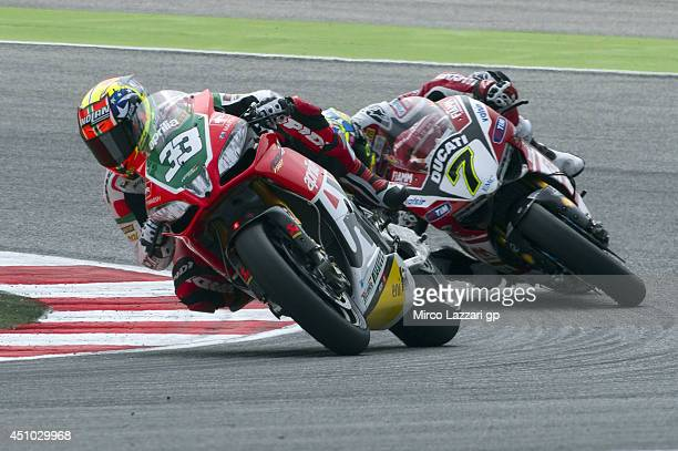 Marco Melandri of Italy and Aprilia Racing Team leads Chaz Davies of Great Britain and Ducati Superbike Team during the Superbike race 1 during the...