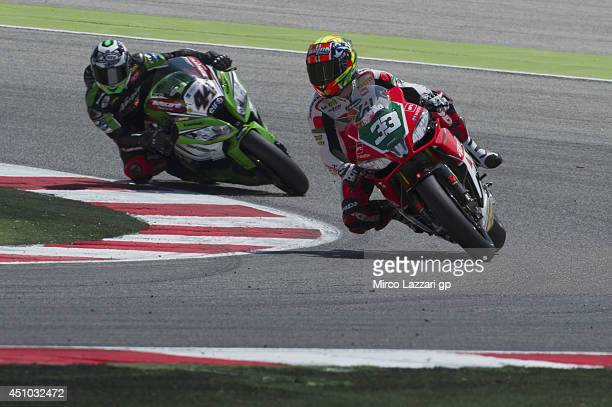 Marco Melandri of Italy and Aprilia Racing Team leads David Salom of Spain and Kawasaki Racing Team during the Superbike race 2 during the FIM...