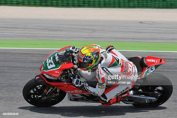 Marco Melandri of Italy and Aprilia Racing Team rounds the bend during the FIM Superbike World Championship Qualifying at Misano World Circuit on...