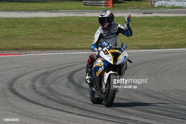 Marco Melandri of Italy and BMW Motorrad GoldBet SBK greets the fans at the end of the race 2 of World Superbikes Race during the round four of 2013...