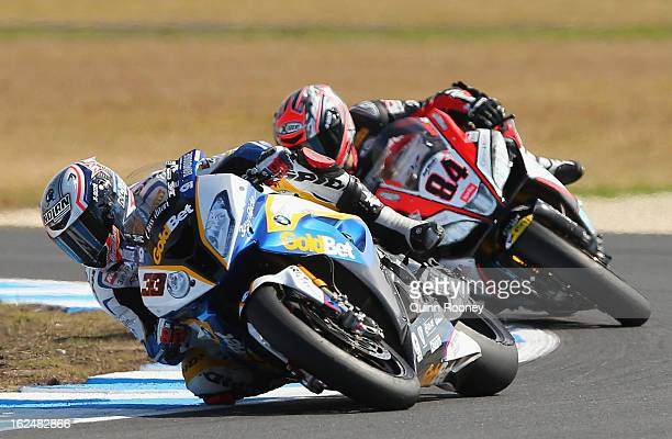 Marco Melandri of Italy riding the BMW Motorrad Goldbet SBK Team leads Michel Fabrizio of Italy riding the Red Devils Roma Aprilia during the World...