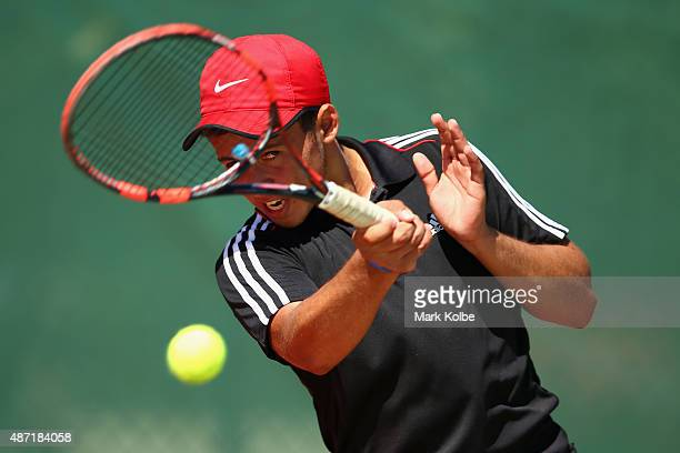 Marco Mendez of Belize plays a forehand during his boys singles first round tennis match at the Apia Park Sports Complex on day one of the Samoa 2015...