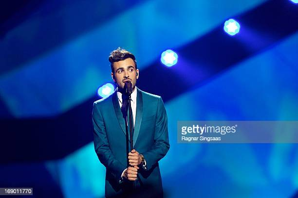 Marco Mengoni of Italy performs on stage during the grand final of the Eurovision Song Contest 2013 at Malmo Arena on May 18 2013 in Malmo Sweden