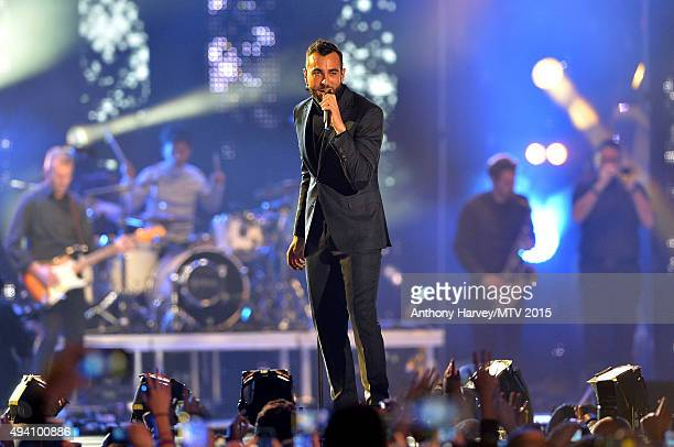 Marco Mengoni performs on stage at the Milan Music Week World Stage ahead of the MTV EMA's 2015 at Piazza Duomo on October 24, 2015 in Milan, Italy.