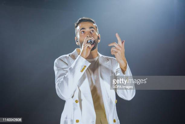 Marco Mengoni seen performing live on stage at the Pala Alpitour in Turin during his Atlantico Tour 2019