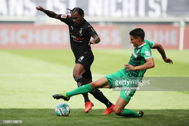 Marco Meyerhoefer of Fuerth challenges Valentino Lazaro of Moenchengladbach during the preseason friendly match between Borussia Monechengladbach and...