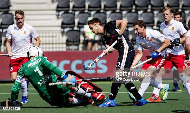 Marco Miltkau of Germany vies with George Pinner of England during the hockey semi final match between Germany and England at the Rabo EuroHockey...