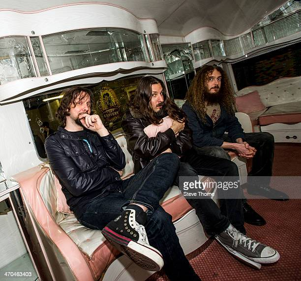 Marco Minneman Bryan Beller and Guthrie Govan of The Aristocrats pose backstage at the Assembly on February 19 2014 in Leamington Spa United Kingdom