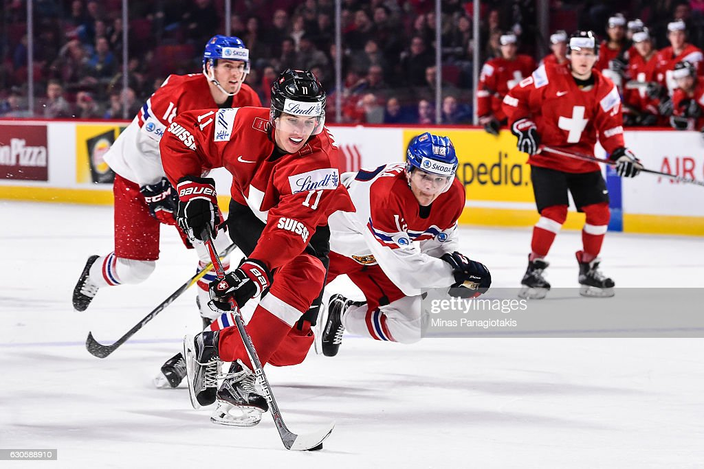Marco Miranda #11 of Team Switzerland skates the puck against Frantisek Hrdinka #12 of Team Czech Republic during the IIHF World Junior Championship preliminary round game at the Bell Centre on December 27, 2016 in Montreal, Quebec, Canada. Team Switzerland defeated Team Czech Republic 4-3 in overtime.