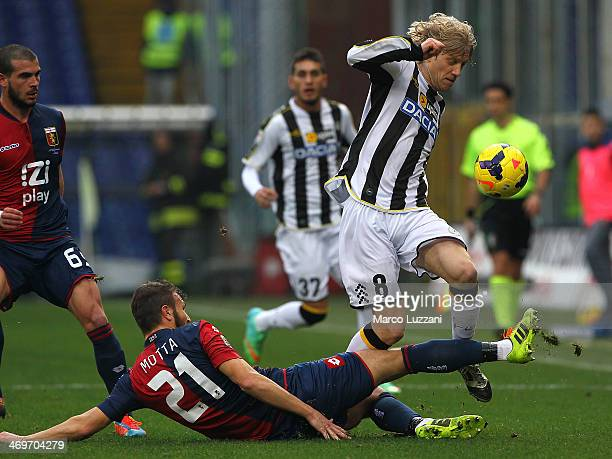 Marco Motta of Genoa CFC tackles Dusan Basta of Udinese Calcio during the Serie A match between Genoa CFC and Udinese Calcio at Stadio Luigi Ferraris...