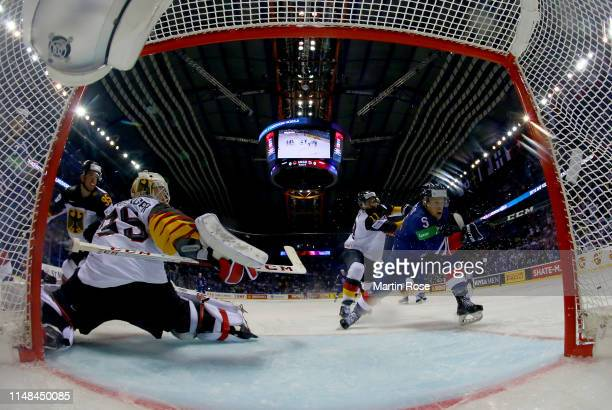 Marco Nowak of Germany challenges Ben Davies of Great Britain during the 2019 IIHF Ice Hockey World Championship Slovakia group A game between...