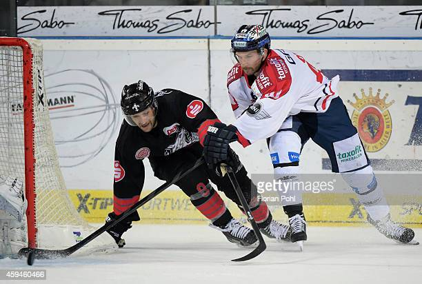 Marco Nowak of the Thomas Sabo Ice Tigers Nuernberg and Darin Olver of the Eisbaeren Berlin in action during the game between Thomas Sabo Ice Tigers...